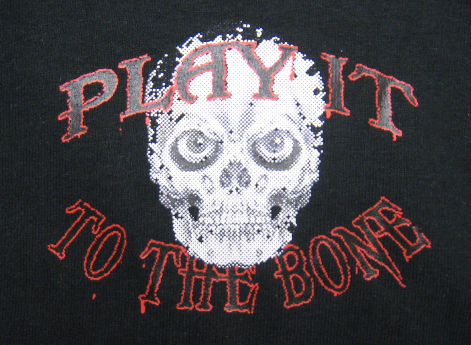 Play It To The Bone logo on shirt by Code Four Athletics