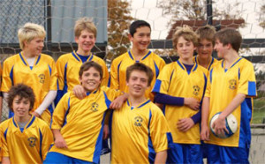 Soccer team in royal/gold Imperial soccer jerseys by Code Four Athletics